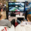Teenagers play video games at Pioneer stand — Stock Photo