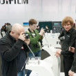 Photographers examine Fujifilm X-Pro1 — Stock Photo #13319798