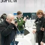 Постер, плакат: Photographers examine Fujifilm X Pro1