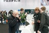 Photographers examine Fujifilm X-Pro1 — Stock Photo