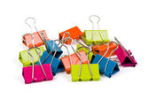 Heap of color binder clips — Stock Photo