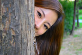Hiding behind the tree — Stock Photo