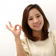 Beautiful female giving okay sign — Stock Photo