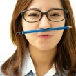 Smiling woman with a pen — Stock Photo