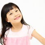 Happy little girl on white background — Stock Photo #22888598