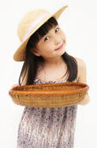 Little girl with basket — Stock Photo