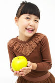 Cute asian kid with an apple — Stock Photo