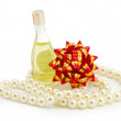 Perfume, pearls, bow — Stock Photo