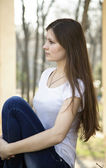 Young beautiful woman sitting alone — Stockfoto