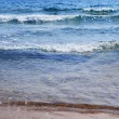 Sandy beach, sea shore with waves — Stock Photo