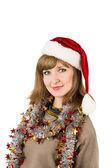 Kobieta w kapeluszu santa claus — Zdjęcie stockowe