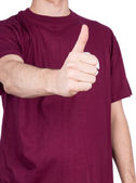 Man in T-shirt shows thumbs up — 图库照片