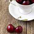 Sweet cherries in a white cup — Stock Photo #18336267