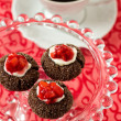 Chocolate thumbprint cookies with cream cheese and strawberries — Stock Photo #18336521