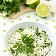 White rice with lime and parsley in a bowl — Stock Photo