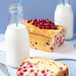 Cornmeal cake with red currant served with milk — Stock Photo