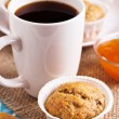 Fresh vegan banana muffin with a cup of coffee — Stock Photo