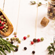 Stock Photo: Herbs and spices on white table