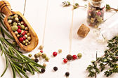 Herbs and spices on a white table — Stock Photo