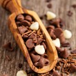 Stock Photo: Chocolate drops and sprinkles in wooden scoop