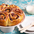 Sweet rolls with dried fruits and dripping glaze — Stock Photo
