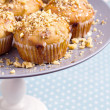 Stock Photo: Bananmuffins with walnuts and white chocolate on cake stand