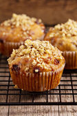 Banana muffins with walnuts and white chocolate on a cooling rack — Stock Photo