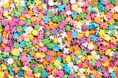 Colorful sprinkles background — Stock Photo