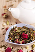 Green tea with fruits, spices, rose petals and bamboo leaves — Stock Photo