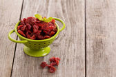 Dried cranberries in a green colander — Stock Photo