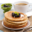 Stacked pancakes with berries — Stock Photo #35558069