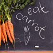 Fresh carrot with green leaves — Stock Photo