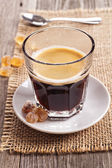 Black coffee in a glass — Stock Photo