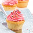 Cupcakes with frosting and sprinkles — Stock Photo #37106589