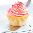 Cupcake with frosting and sprinkles — Stock Photo