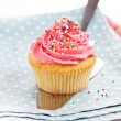 Cupcake with frosting and sprinkles — Stock Photo #37106873
