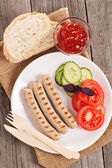 Grilled pork sausages on a plate — Stock Photo