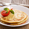 Stock Photo: Savory pancakes with tomatoes