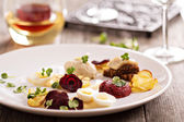 Gourmet salad with beet and herring — Stock Photo