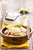 Udon noodles with vegetables and chicken — Stock Photo
