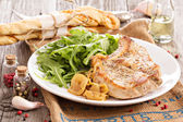 Roasted pork with apples and onions — Stock Photo