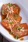 Salmon sashimi with ginger and sesame — Stock Photo