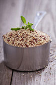 Quinoa in a measuring cup — Stock Photo