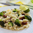 Pasta with broccoli and dried tomatoes — Stock Photo