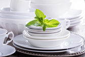 Variety of white dinnerware — Stock Photo