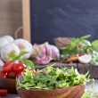 Green salad leaves in a wooden bowl — Stock Photo #43954447