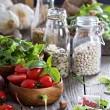 Tomatoes, salad leaves, beans and rice — Stock Photo
