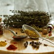 Variety of spices and herb on a wooden board — Stock Photo #46265611