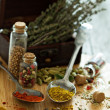 Variety of spices and herb on a wooden board — Stock Photo #46265633