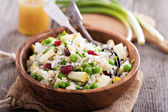 Salad with rice, apple, cranberry and peas — Stock Photo